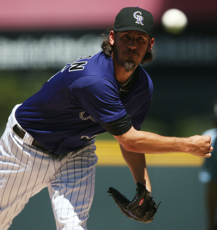 . Colorado Rockies starting pitcher Christian Bergman works against the San Francisco Giants in the first inning of a baseball game in Denver on Wednesday, Sept. 3, 2014. (AP Photo/David Zalubowski)