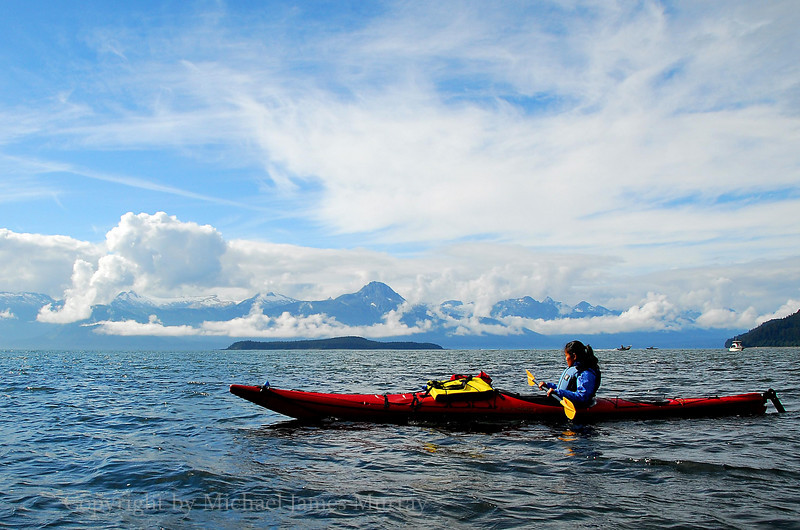 Kayaker in Lynn Canal with Chilkat Mountains as Backdrop, Juneau, Alaska