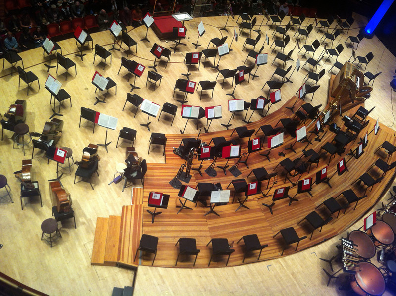 The orchestra stage seen from seats directly above and behind it. (Cell phone photo)
