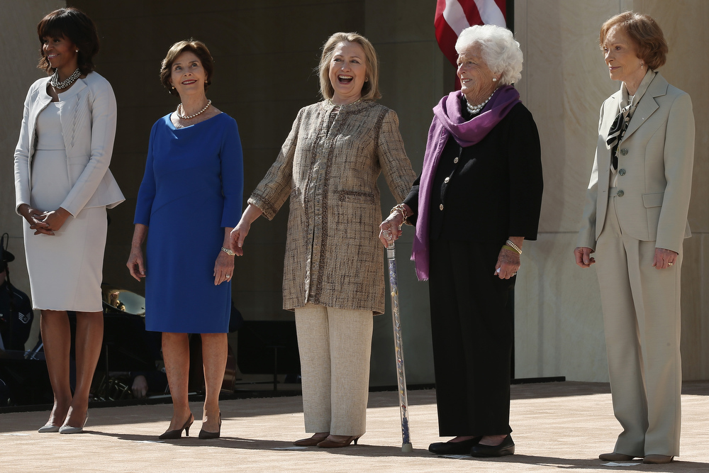 Description of . First lady Michelle Obama, former first lady Laura Bush, former first lady Hillary Clinton, former first lady Barbara Bush and former first lady Rosalynn Carter attend the opening ceremony of the George W. Bush Presidential Center April 25, 2013 in Dallas, Texas. The Bush library, which is located on the campus of Southern Methodist University, with more than 70 million pages of paper records, 43,000 artifacts, 200 million emails and four million digital photographs, will be opened to the public on May 1, 2013. The library is the 13th presidential library in the National Archives and Records Administration system.  (Photo by Alex Wong/Getty Images)