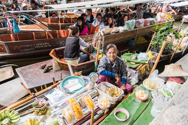 Dec 2017 -  A Lady selling bananas at The Damnoen Saduak Floating River Market, Bangkok, Thailand