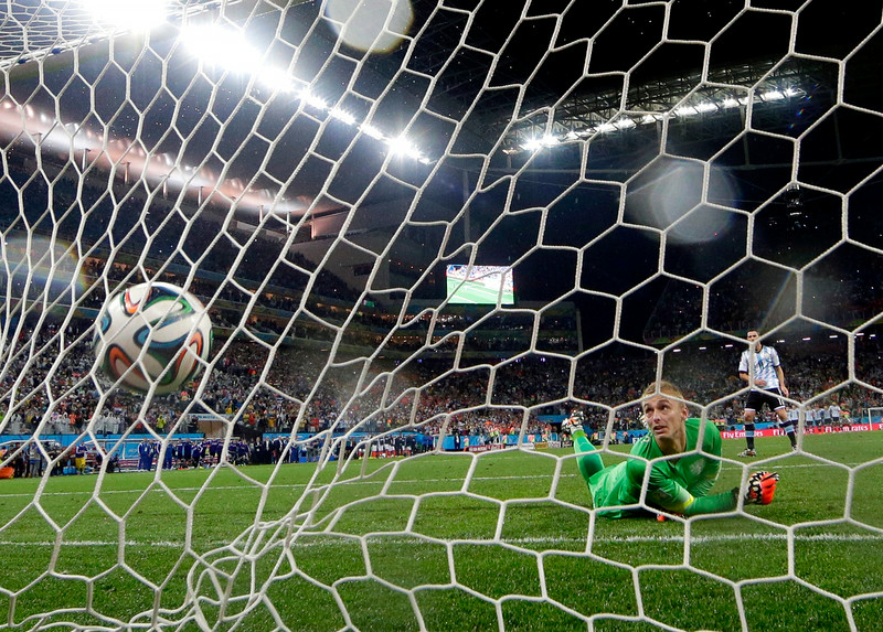 . Argentina\'s Maxi Rodriguez shoots the winning shot against Netherlands\' goalkeeper Jasper Cillessen during a penalty shootout after extra time during the World Cup semifinal soccer match between the Netherlands and Argentina at the Itaquerao Stadium in Sao Paulo Brazil, Wednesday, July 9, 2014. Argentina defeated the Netherlands 4-2 in a penalty shootout after a 0-0 tie to advance to the finals. (AP Photo/Victor R. Caivano)