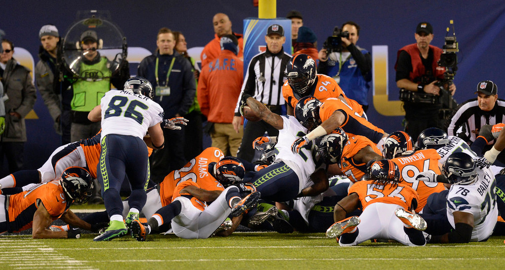 . Seattle Seahawks running back Marshawn Lynch (24) drives into end zone for a second quarter touchdown. The Denver Broncos vs the Seattle Seahawks in Super Bowl XLVIII at MetLife Stadium in East Rutherford, New Jersey Sunday, February 2, 2014. (Photo by AAron Ontiveroz/The Denver Post)
