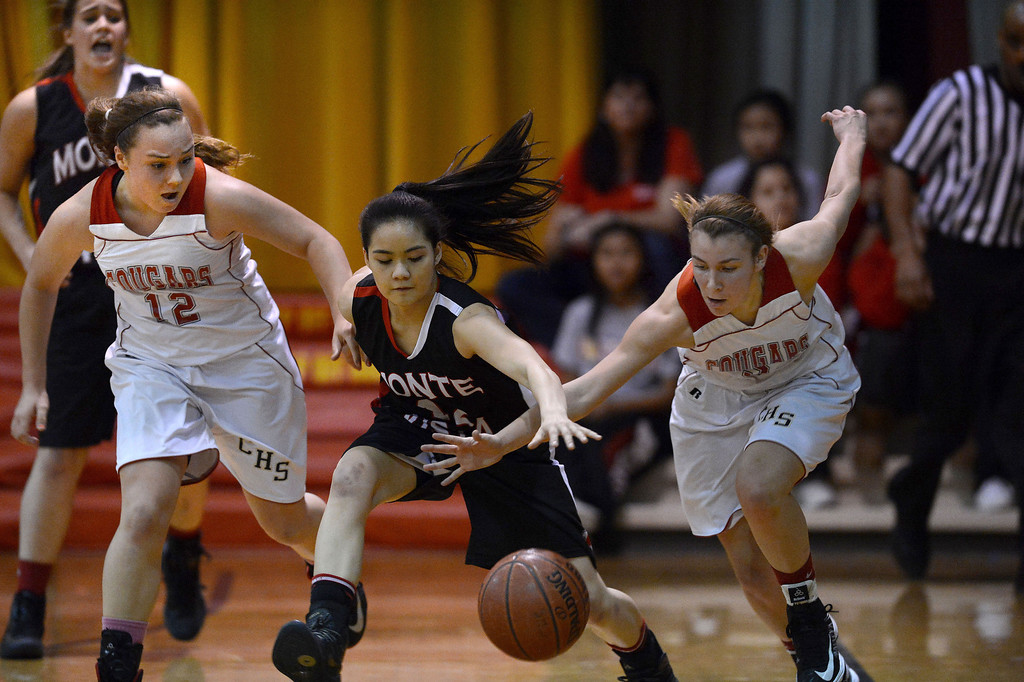 . Carondelet High\'s Marcella Hughes (12) and Natalie Romeo (5) battle Monte Vista High\'s Angela Rigo (12) for a loose ball in their high school basketball game played at Carondelet High School in Concord, Calif. on Friday, Feb. 1, 2013. (Dan Honda/Staff)