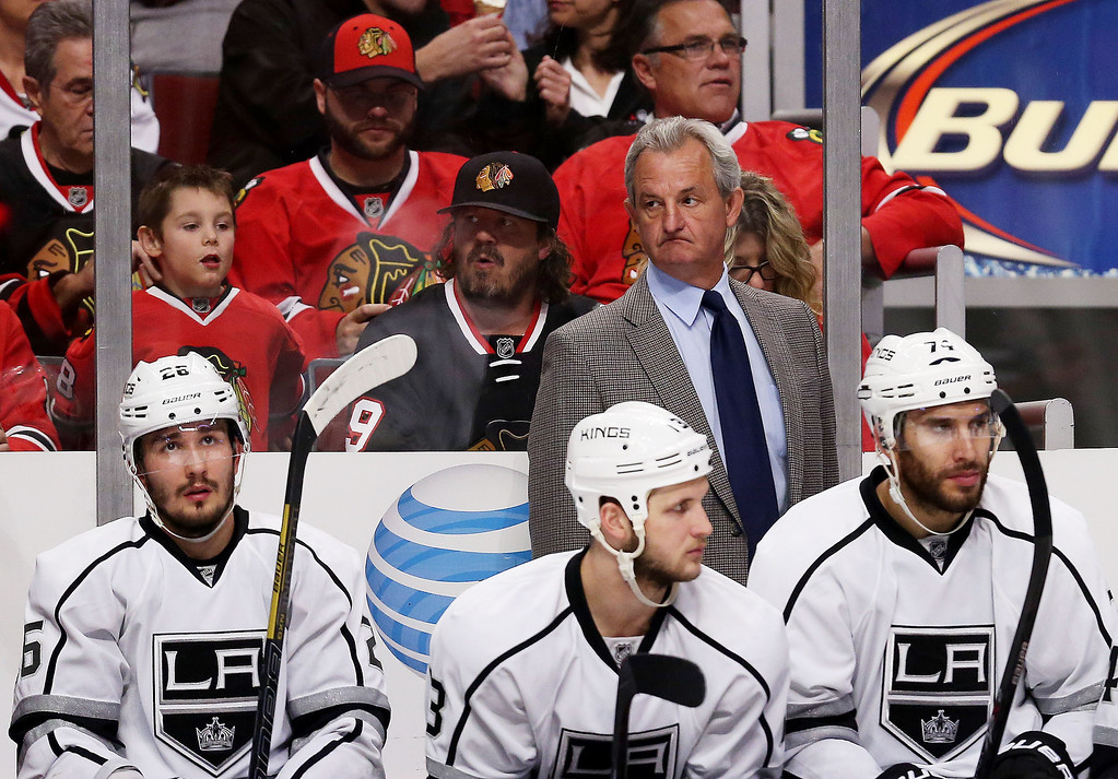 . Darryl Sutter of the Los Angeles Kings looks on against the Chicago Blackhawks in Game One of the Western Conference Final during the 2014 Stanley Cup Playoffs at United Center on May 18, 2014 in Chicago, Illinois.  (Photo by Jonathan Daniel/Getty Images)