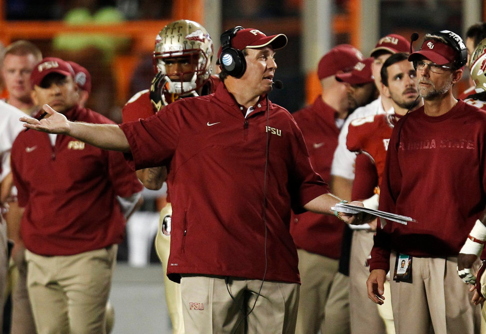 . Florida State Seminoles head coach Jimbo Fisher (C) directs his team\'s play against the Northern Illinois Huskies during their 2013 Discover Orange Bowl NCAA football game in Miami, Florida January 1, 2013.  REUTERS/Jeff Haynes
