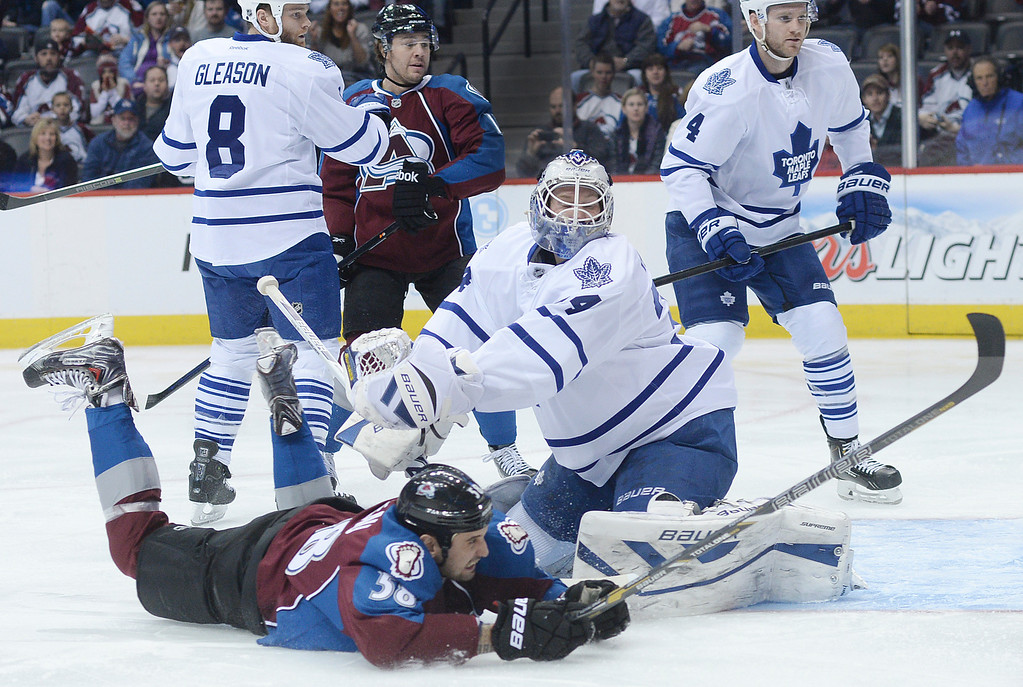 . DENVER, CO. - JANUARY 21:  Colorado wing Patrick Bordeleau (58) fell to the ice in front of Toronto goaltender James Reimer (34) in the first period. The Colorado Avalanche hosted the Toronto Maple Leafs Tuesday night, January 21, 2014 at the Pepsi Center. Photo By Karl Gehring/The Denver Post