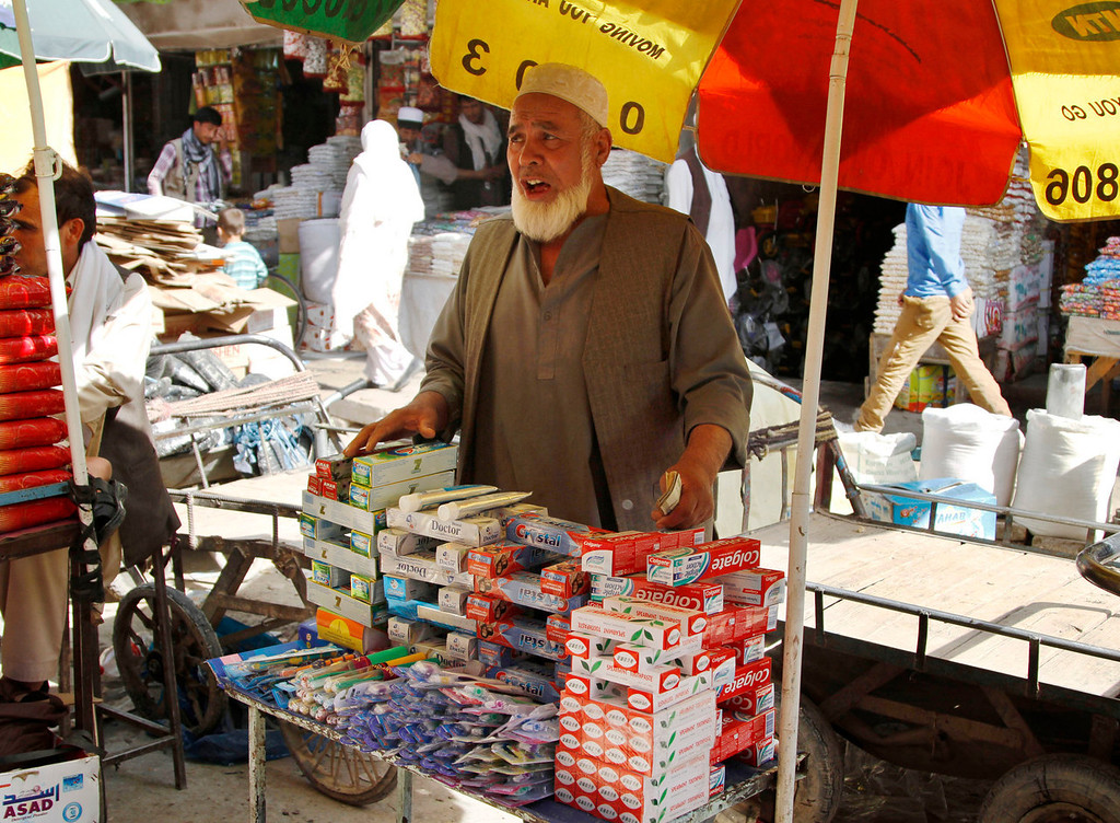 . Abdul Wasay, 75, sells toothbrushes and toothpaste on a busy street market In Kabul, Afghanistan, where he says he usually spends most of his days. In a country with no pension system for people not in government service, it\'s a hard life for the former blacksmith and cook. He makes just $6 a day and it\'s barely enough to help support his wife. (AP Photo/Ahmad Jamshid)