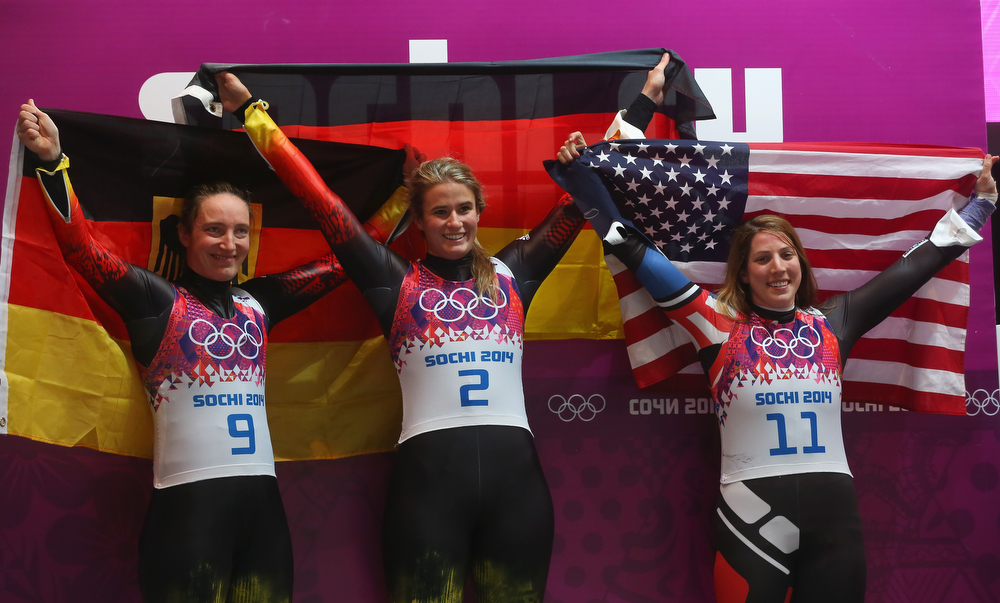 . Gold medalist Natalie Geisenberger (C), silver medalist Tatjana Huefner (L) of Germany and bronze medalist Erin Hamlin of the United States celebrate after the Women\'s Luge Singles on Day 4 of the Sochi 2014 Winter Olympics at Sliding Center Sanki on February 11, 2014 in Sochi, Russia.  (Photo by Alexander Hassenstein/Getty Images)