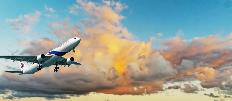 Aircraft in flight with Colourful cumulonimbus cloud in blue sky. Australia.