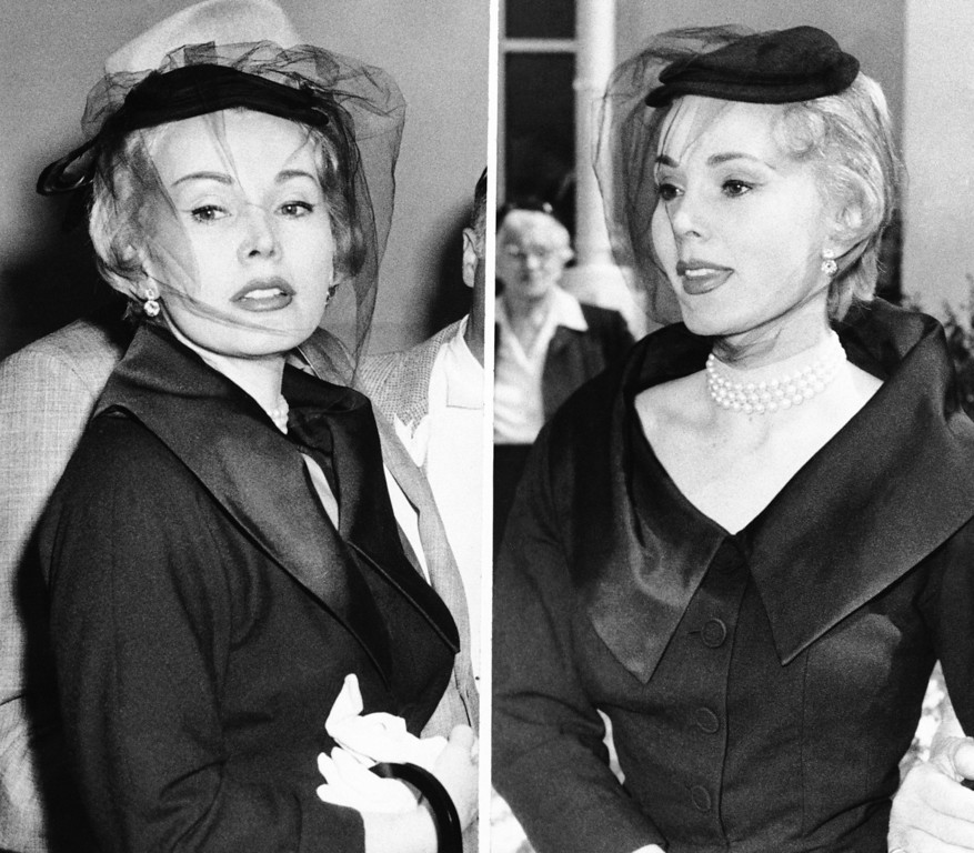 ". Looking chic and glamorous in mourning black, Zsa Zsa Gabor leaves court on April 1, 1954 in Santa Monica, Calif., after divorcing her third husband, actor George Sanders.   She describes Sanders  as ""a born bachelor.\""   She explained her black attire thus: \""I am little bit in mourning.\""  (AP Photo/Harold P. Matosian)"