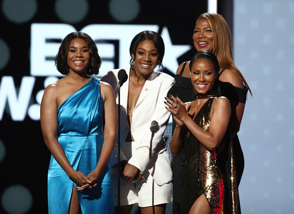 . Regina Hall, from left, Tiffany Haddish, Jada Pinkett Smith and Queen Latifah present the lifetime achievement award at the BET Awards at the Microsoft Theater on Sunday, June 25, 2017, in Los Angeles. (Photo by Matt Sayles/Invision/AP)