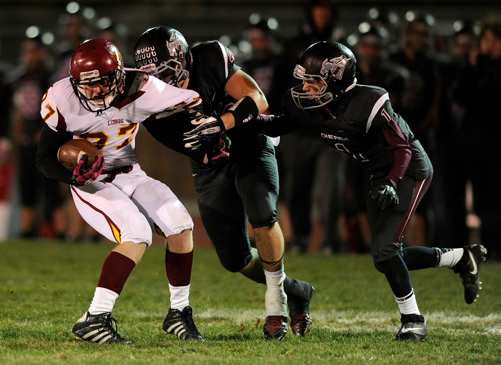 . Chatfield senior linebacker Brendan Murphy (33) dragged down Rocky Mountain running back Cade Hairgrove (27) in the second half.   Photo By Karl Gehring/The Denver Post