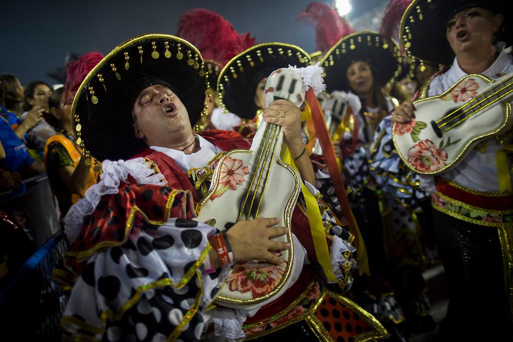 . A performer from the Academicos do Grande Rio samba school parades during Carnival celebrations at the Sambadrome in Rio de Janeiro, Brazil, Monday, Feb. 27, 2017. (AP Photo/Mauro Pimentel)