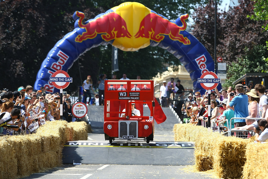 . A team makes its way down the course at Alexandra Palace on July 14, 2013 in London, England. The Red Bull Soapbox Race returned to London after nine years and encourages competitors to build and race their own homemade soapboxes down a hill.  (Photo by Jordan Mansfield/Getty Images)