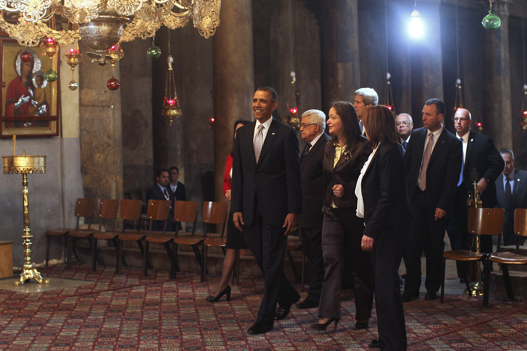 . U.S. President Barack Obama (L) visits the Church of the Nativity with Palestinian President Mahmoud Abbas (2L) on March 22, 2013 in Bethlehem, West Bank.  (Photo by Atef Safadi-Pool/Getty images)