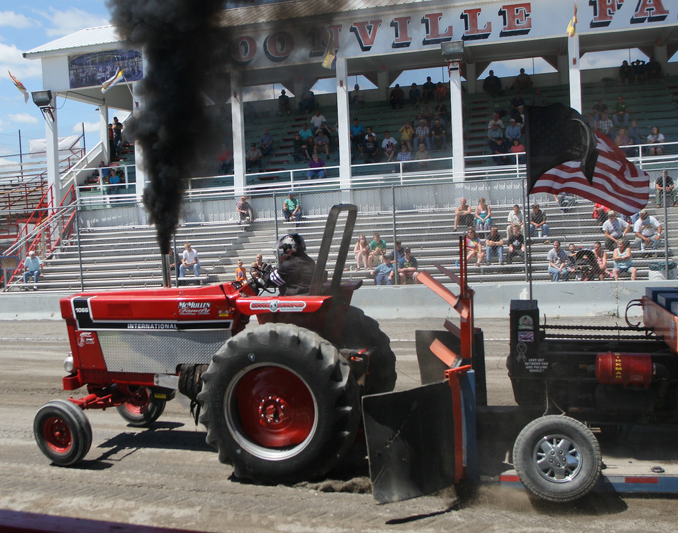. Dustin McMullen  competes in the tractor pull competition at the Boonville Oneida County Fair on Thursday, July 24, 2014 in Boonville. McMullen pulled 277 feet on his attempt The fair runs through Sunday, July 27, 2014. JOHN HAEGER-ONEIDA DAILY DISPATCH @ONEIDAPHOTO ON TWITTER