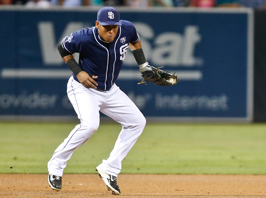. San Diego Padres third baseman Yangervis Solarte snares a hard shot off the bat of Colorado Rockies\' Drew Stubbs in the first inning of a baseball game Tuesday, Sept. 23, 2014, in San Diego.  Solarte threw out Stubbs at first. (AP Photo/Lenny Ignelzi)