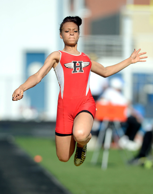 . Maribeth Joeright/MJoeright@News-Herald.com<p> Harvey\'s Alexis Daniels qualifies for the state meet with her long jump during the Division I regional finals, May 30, 2014.