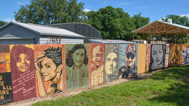 Pop art portraits mounted to residential fence