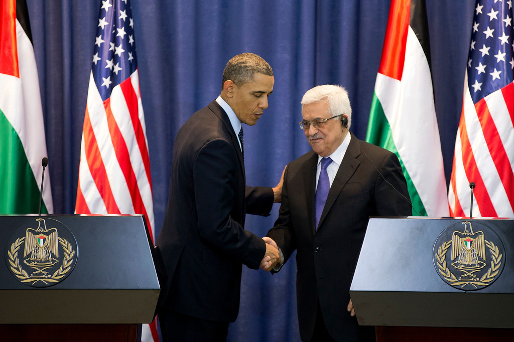 . U.S. President Barack Obama and Palestinian President Mahmoud Abbas shake hands during a joint news conference at the Muqata Presidential Compound, Thursday, March 21, 2013, in the West Bank town of Ramallah. (AP Photo/Carolyn Kaster)