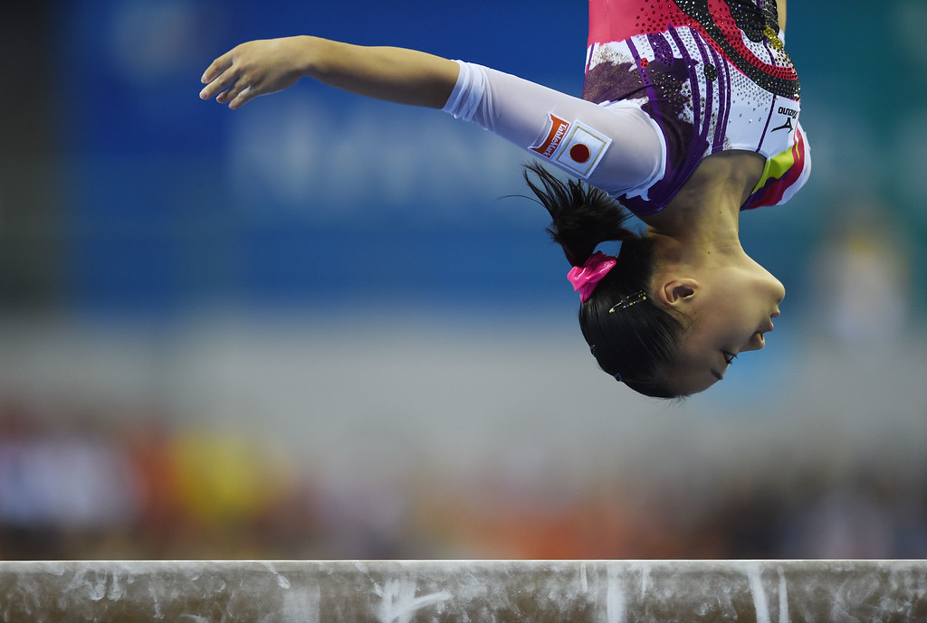 . Japan\'s Azumi Ishikura performs on the beam during the women\'s qualification round at the Gymnastics World Championships in Nanning, in China\'s southern Guangxi province on October 6, 2014. GREG BAKER/AFP/Getty Images