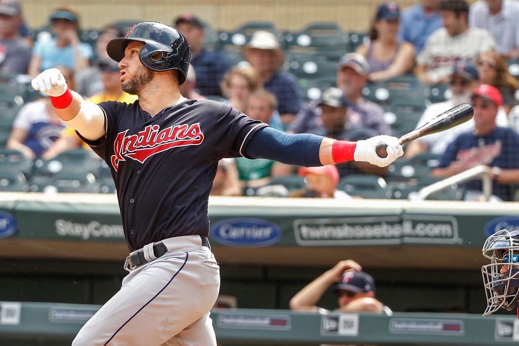 . Cleveland Indians Yan Gomes hits an RBI single against the Minnesota Twins in the ninth inning of a baseball game Wednesday, Aug. 1, 2018, in Minneapolis. The Indians won 2-0. (AP Photo/Bruce Kluckhohn)