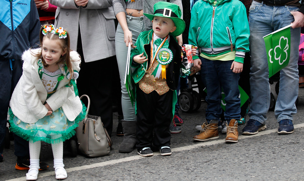 . Children wait to catch a view of the St Patrick\'s day parade in the center of Belfast, Northern Ireland, Tuesday, March 17, 2015. (AP Photo/Peter Morrison)