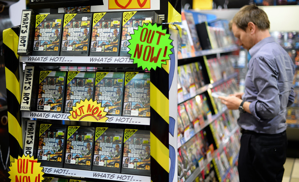 . Console game Grand Theft Auto 5 are seen at an electronics store in the central business district of Sydney on September 17, 2013. At midnight the doors of select games stores were opened for the launch of the much-awaited Grand Theft Auto 5 game in Australia.       (SAEED KHAN/AFP/Getty Images)