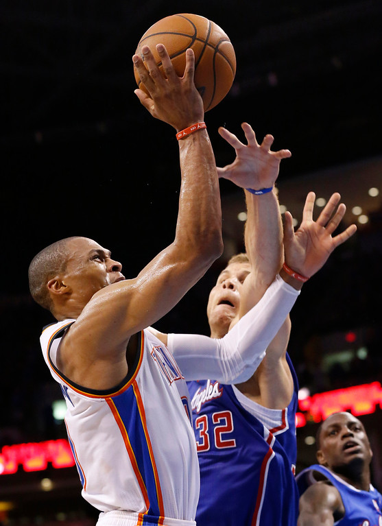 . Oklahoma City Thunder guard Russell Westbrook (0) is fouled by Los Angeles Clippers forward Blake Griffin (32) in the third quarter of Game 1 of the Western Conference semifinal NBA basketball playoff series in Oklahoma City, Monday, May 5, 2014. Los Angeles won 122-105. (AP Photo/Sue Ogrocki)