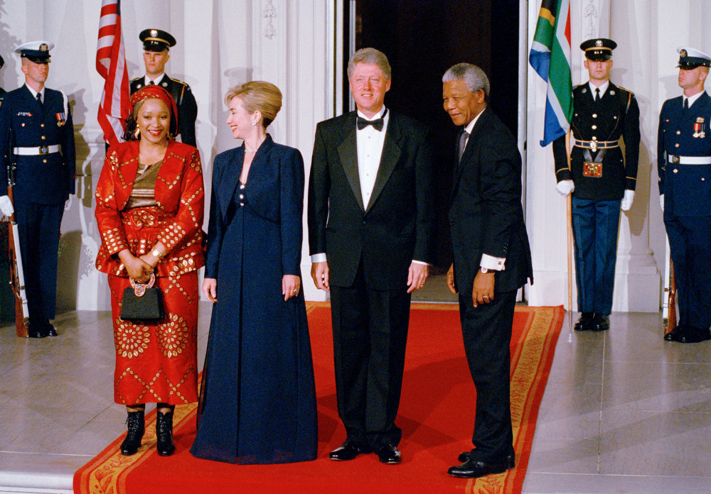 Description of . President Bill Clinton and Mrs. Hillary Clinton stand with South Africa President Nelson Mandela and his daughter, Zinzi Mandela Hlongwane on Tuesday night, Oct. 4, 1994 at the North Portico of the White House. The Clintons are hosting a state dinner for Mandela. (AP Photo/Marcy Nighswander)