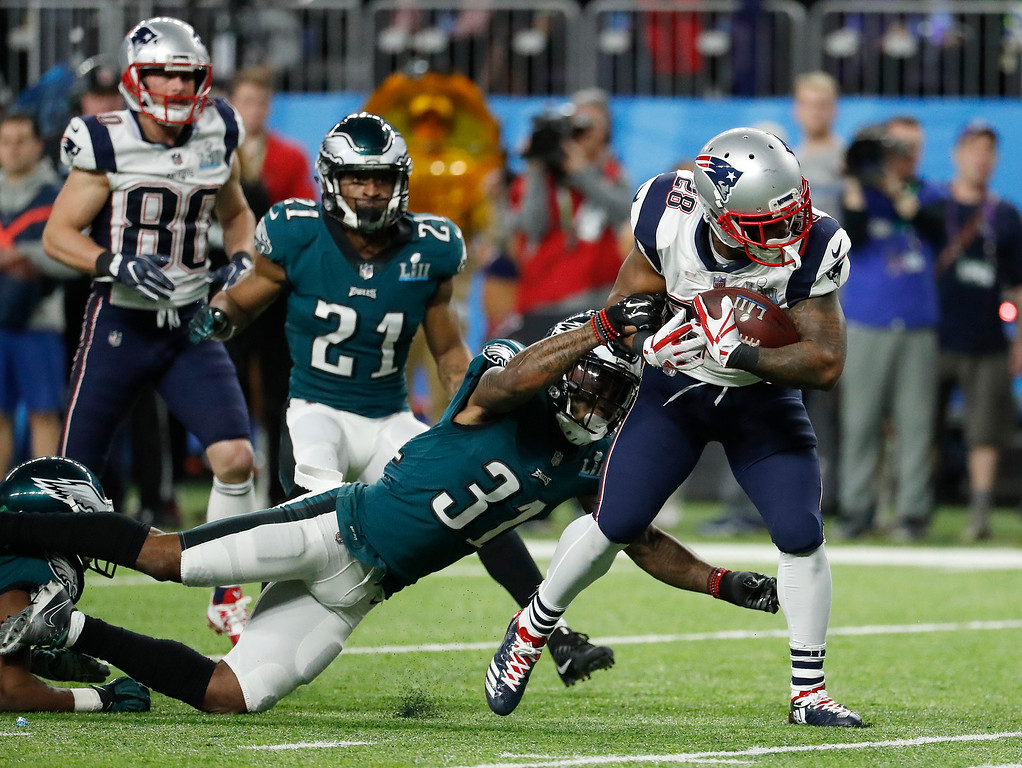 . New England Patriots\' James White (28) runs for a touchdown during the first half of the NFL Super Bowl 52 football game against the Philadelphia Eagles Sunday, Feb. 4, 2018, in Minneapolis. (AP Photo/Matt York)