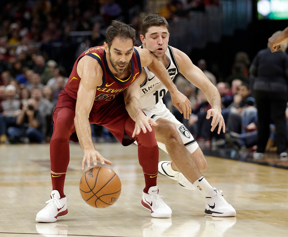 . Cleveland Cavaliers\' Jose Calderon (81), from Spain, drives around Brooklyn Nets\' Joe Harris (12) during the first half of an NBA basketball game, Wednesday, Nov. 22, 2017, in Cleveland. (AP Photo/Tony Dejak)
