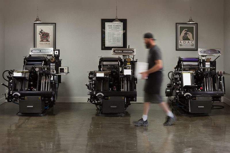Chico Commercial Photography-Print-shop-working-walking-by-old-fashion-printing-press.jpg