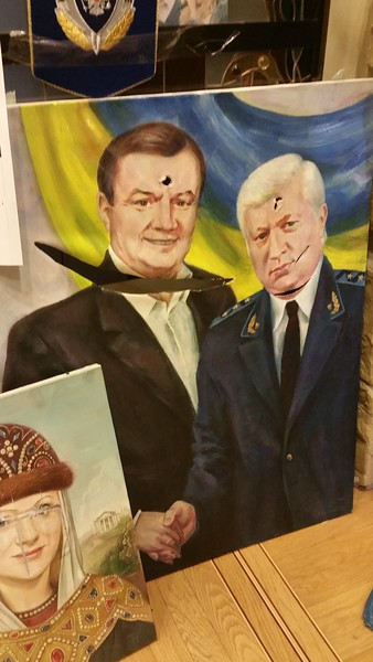I see some rather disturbing canvas`s of the former President that have been desecrated.