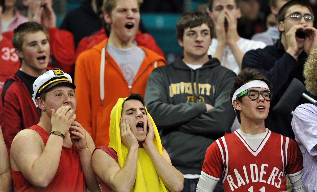 . DENVER, CO. - MARCH 08: Regis High School students cheer the boys basketball team during the playoff game against Eaglecrest Highschool at Denver Coliseum. March 8, 2013. Denver, Colorado. Eaglecrest won 64-57. (Photo By Hyoung Chang/The Denver Post)