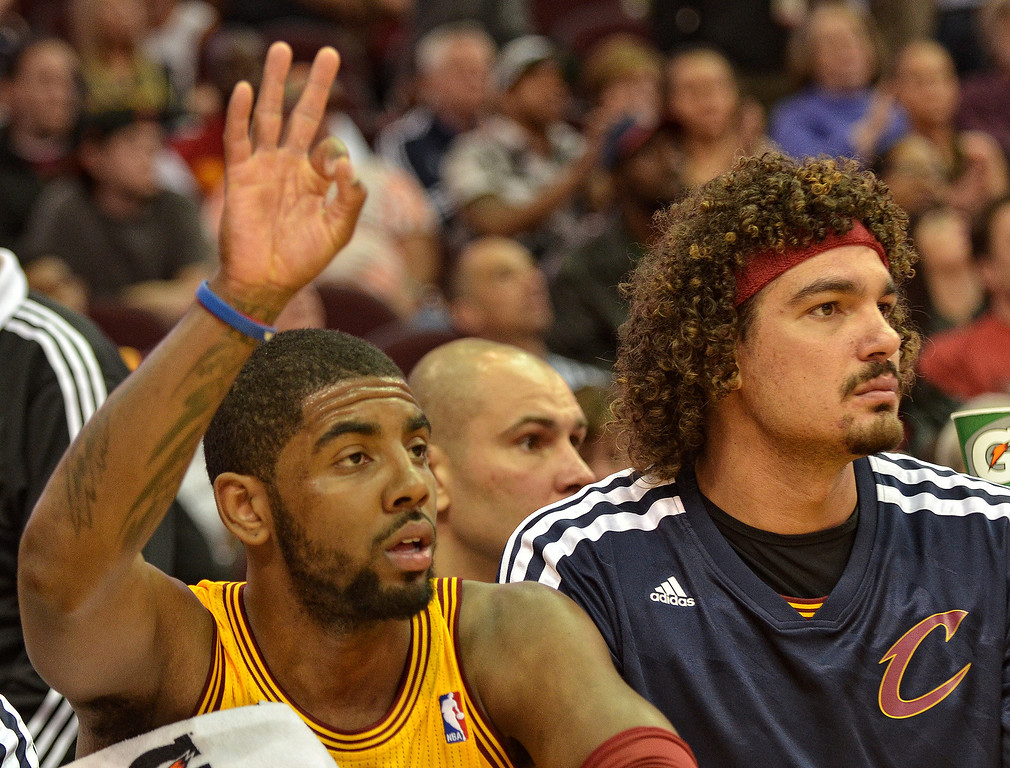 . Michael Allen Blair/Digital First Media Cavs\' guard Kyrie Irving signals a three point basket by teammate Jarret Jack while sitting on the bench with two fouls with center Anderson Varejao during the first quarter of Wednesday\'s game at Quicken Loans Arena. Big questions remain with Irving heading into the final year of his contract next season.