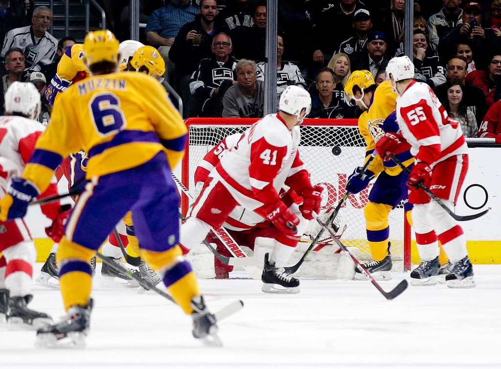 . Los Angeles Kings defenseman Jake Muzzin (6) watches his goal against the Detroit Red Wings during the first period of an NHL hockey game in Los Angeles, Tuesday, Feb. 24, 2015. (AP Photo/Chris Carlson)