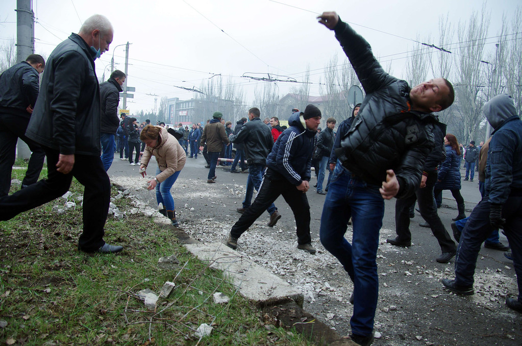 . Pro-Russia protesters throw stones as they storm a regional police building in the eastern Ukrainian city of Horlivka (Gorlovka), near Donetsk, on April 14, 2014. A few hundred pro-Russia activists seized the building after an hour-long storming. U AFP PHOTO/ ALEXEY   KRAVTSOV/AFP/Getty Images