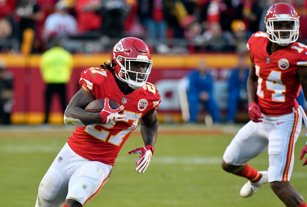 . Kansas City Chiefs running back Kareem Hunt (27) carries the ball in front of wide receiver Demarcus Robinson (14) during the second half of an NFL football game against the Pittsburgh Steelers in Kansas City, Mo., Sunday, Oct. 15, 2017. (AP Photo/Ed Zurga)