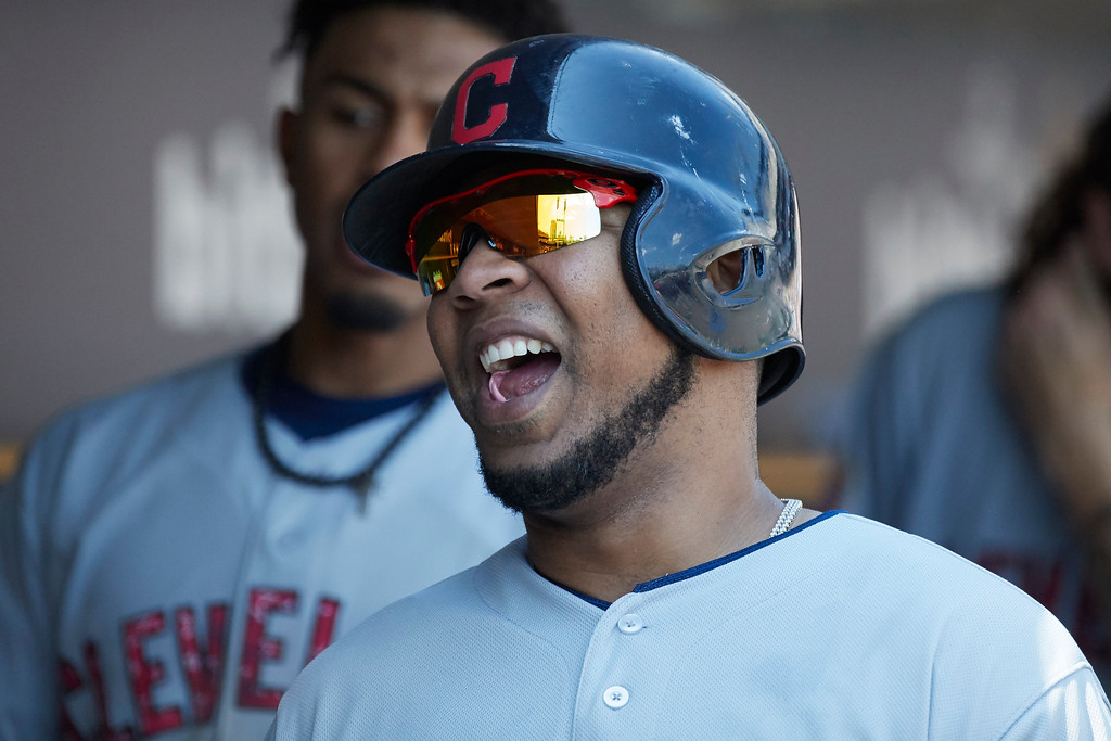 . Cleveland Indians Edwin Encarnacion reacts in the dugout after scoring against the Detroit Tigers in the sixth inning of a baseball game in Detroit, Sunday, July 2, 2017. (AP Photo/Rick Osentoski)