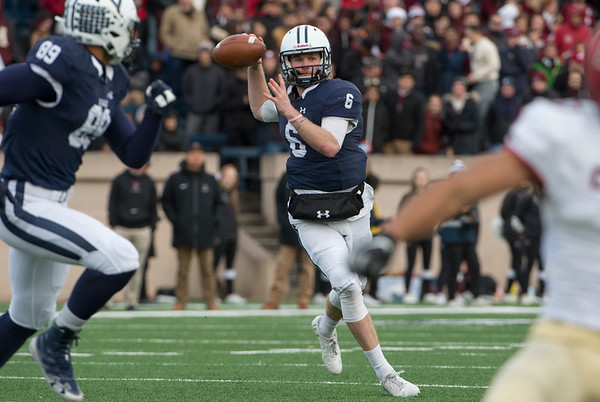 11/23/19 Wesley Bunnell | StaffrrYale rallied late in The Game against Harvard on Saturday afternoon at the Yale Bowl for a 50-43 victory in double over time. QB Kurt Rawlings (6) throws on the run for a completion on the sideline.