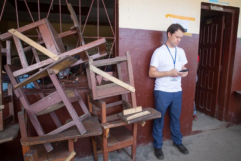 Monrovia, Liberia October 10, 2017 - Jason Carter checks in elction day activity.