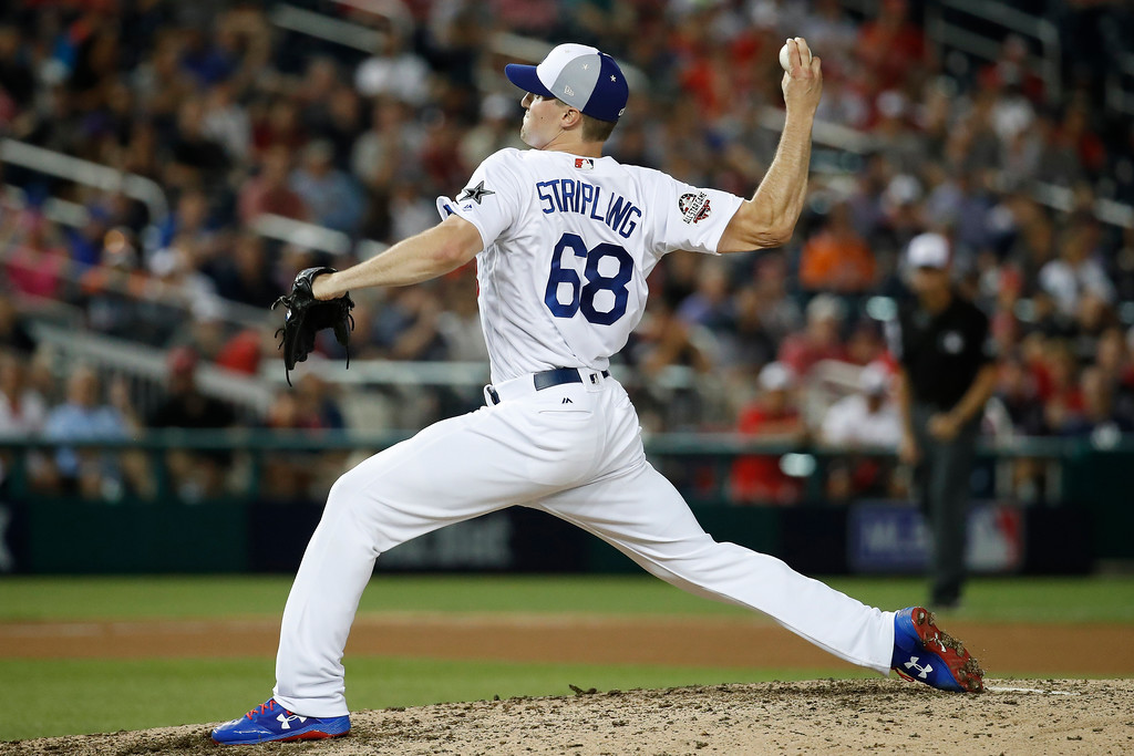 . Los Angeles Dodgers pitcher Ross Stripling (68) throws in the tenth inning during the Major League Baseball All-star Game, Tuesday, July 17, 2018 in Washington. (AP Photo/Alex Brandon)