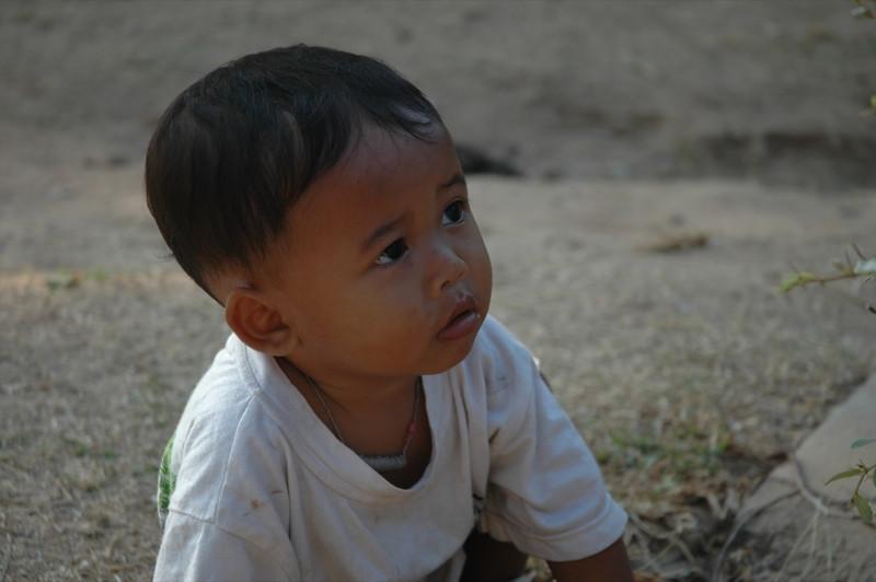 Little Boy Playing Outside Banteay Kdei - Angkor, Cambodia