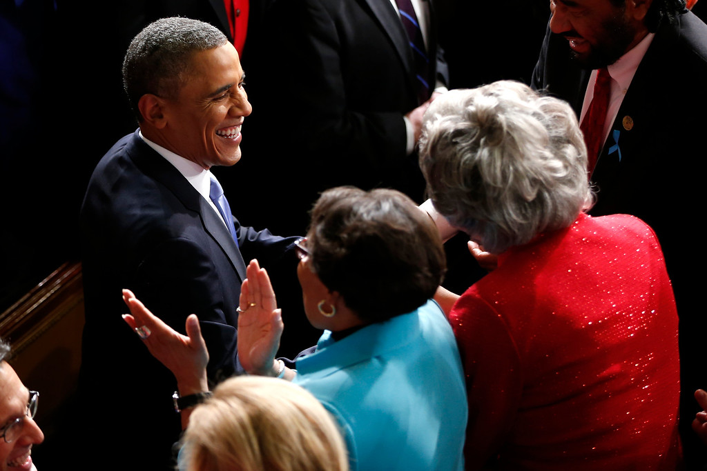 . President Barack Obama is greeted as he arrives to give his State of the Union address on Capitol Hill in Washington, Tuesday Jan. 28, 2014. (AP Photo/Charles Dharapak)