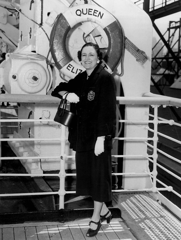 . Miss Ruth Fine of Denver, Colo. is shown as she posed for the photographer aboard the Cunard super liner Queen Elizabeth just before sailing from New York Harbor enroute to Europe where she will tour the continent for six weeks. (Cunard Steam-Ship Co., Ltd.)