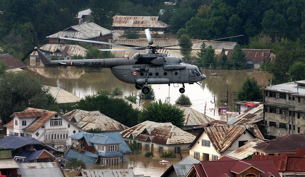 . In this handout photograph released by Ministry of Defense on September 10, 2014 a M-17 helicopter hovers over partially-submerged homes in search of stranded residents in the flood affected part of Srinagar.  AFP PHOTO/MINISTRY OF DEFENCE/AFP/Getty Images
