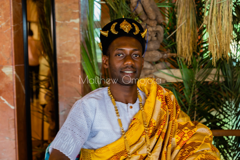 African ivorian culture on display at the president hotel Yamoussoukro. Young Ivorian man wearing traditional african dress with gold jewelry. Promoting culture. African cap,