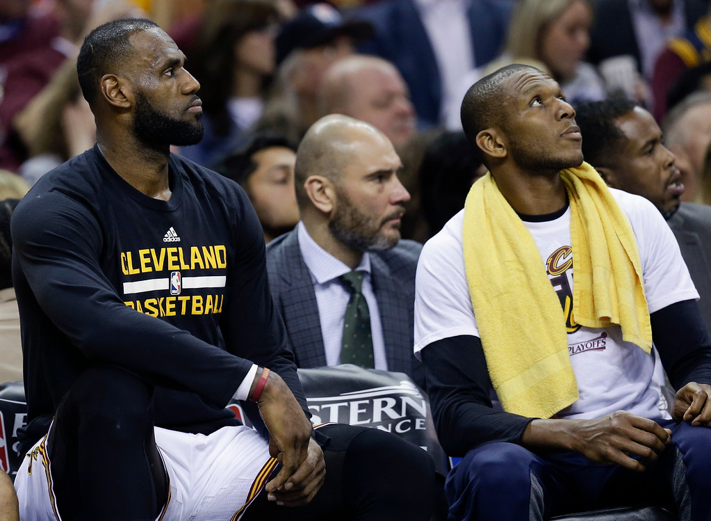 . Cleveland Cavaliers\' James Jones, right, and LeBron James sit on the bench against the Boston Celtics during the first half of Game 4 of the NBA basketball Eastern Conference finals, Tuesday, May 23, 2017, in Cleveland. (AP Photo/Tony Dejak)